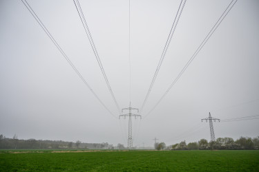 05 April 2019, Lower Saxony, Lehrte: A power pole stands on a field in foggy weather. Photo: Christophe Gateau/dpa (Photo by Christophe Gateau/picture alliance via Getty Images)