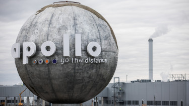 A company logo hangs on a globe sculpture outside the Apollo Tyres Hungary Kft plant in Gyongyoshalasz