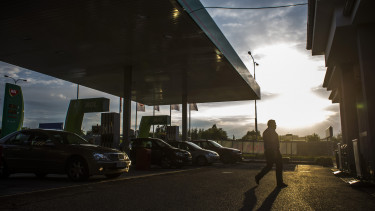 A customer passes a line of automobiles Martin Divisek/Bloomberg via Getty Images