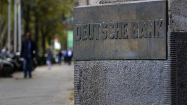 A metal plaque sits outside a Deutsche Bank AG bank branch in Duesseldorf, Germany