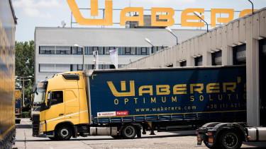 A Waberers heavy goods truck reverses into a loading bay at the Waberer's International Zrt. headquarters in Budapest, Photographer: Akos Stiller/Bloomberg via Getty Images