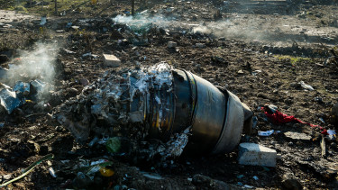 Aircraft parts from the wreckage of a Boeing Co. 737-800 aircraft, operated by Ukraine International Airlines, which crashed shortly after takeoff lie on the ground near Shahedshahr, Iran