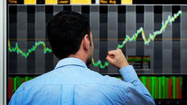 boldog kereskedő trader befektető