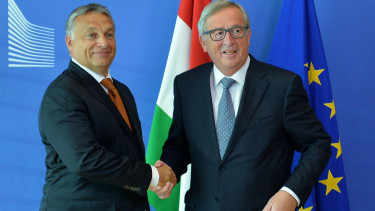 BRUSSELS, BELGIUM - SEPTEMBER 3: Hungarian Prime Minister Viktor Orban (L) and President of the European Commission Jean-Claude Juncker (R) shake hands.