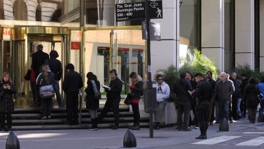 Customers queue outside an exchange house on 3 September 2019 in Buenos Aires, Argentina. After that government imposed capital controls, the people make long lines to withdraw their money from banks. (Photo by Carol Smiljan/NurPhoto via Getty Images)