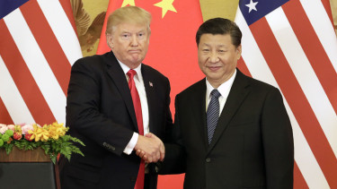 FILE: U.S. President Donald Trump, left, and Xi Jinping, China's president, shake hands during a news conference