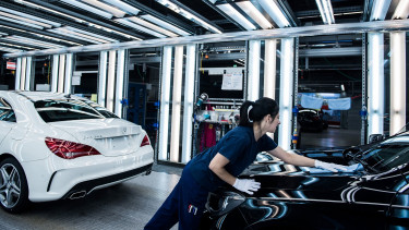 German carmakers may rivisit expansion plans - paper