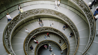 Italy, Rome, Vatican Museum, tourists on staircase,