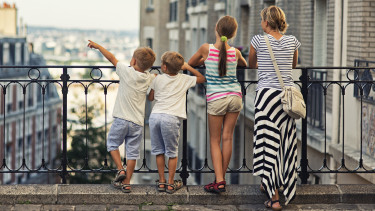 Mother and kids visiting Paris.