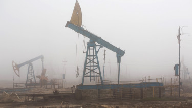 Pumpjacks are shrouded in mist while operating in a field in Baku,Photograph: Taylor Weidman/Bloomberg via Getty Images