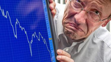 zuhanó piac, aggódó ember